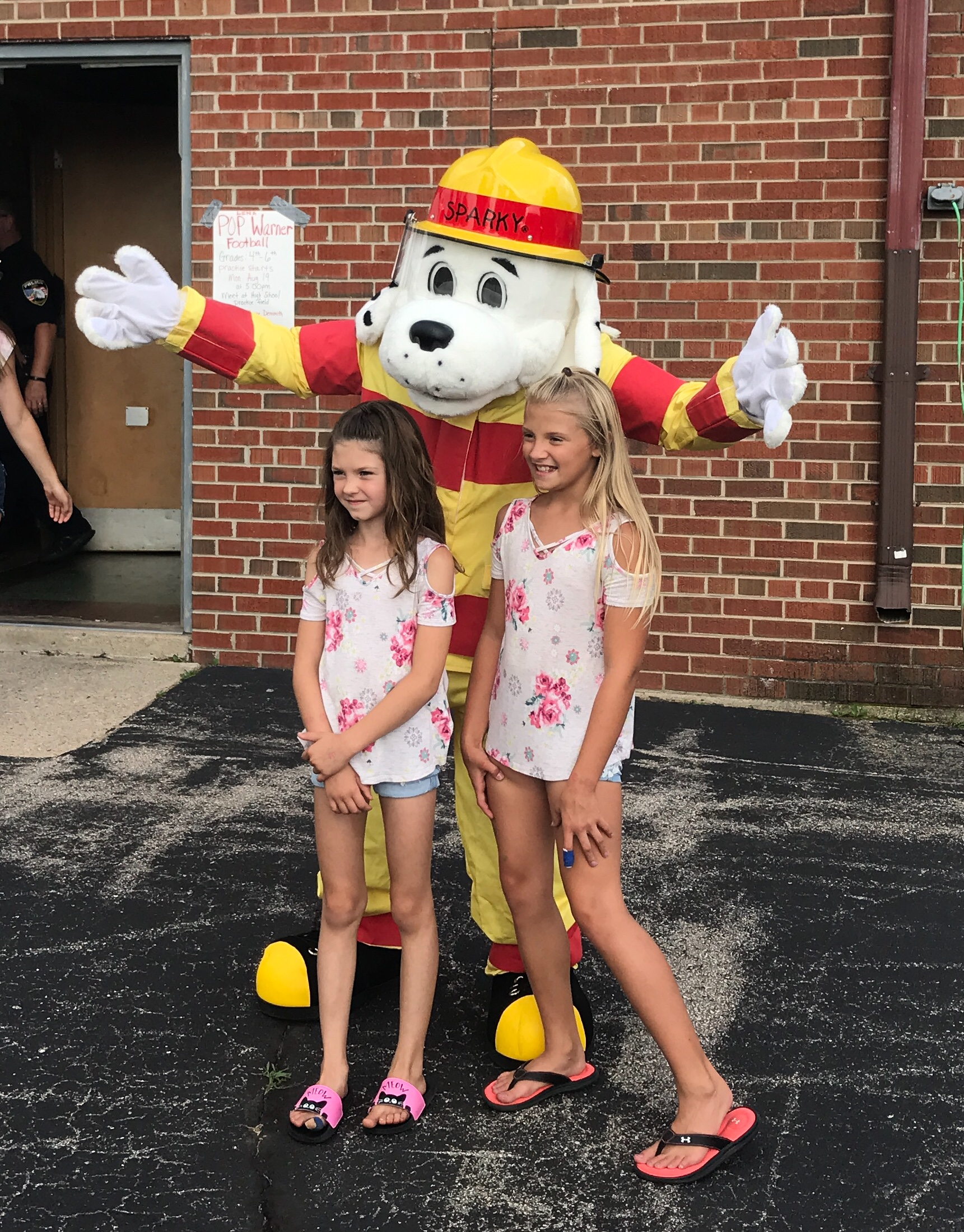 McKenna Suring and Brielle Fischer have a photo op with Sparky the Fire Dog.