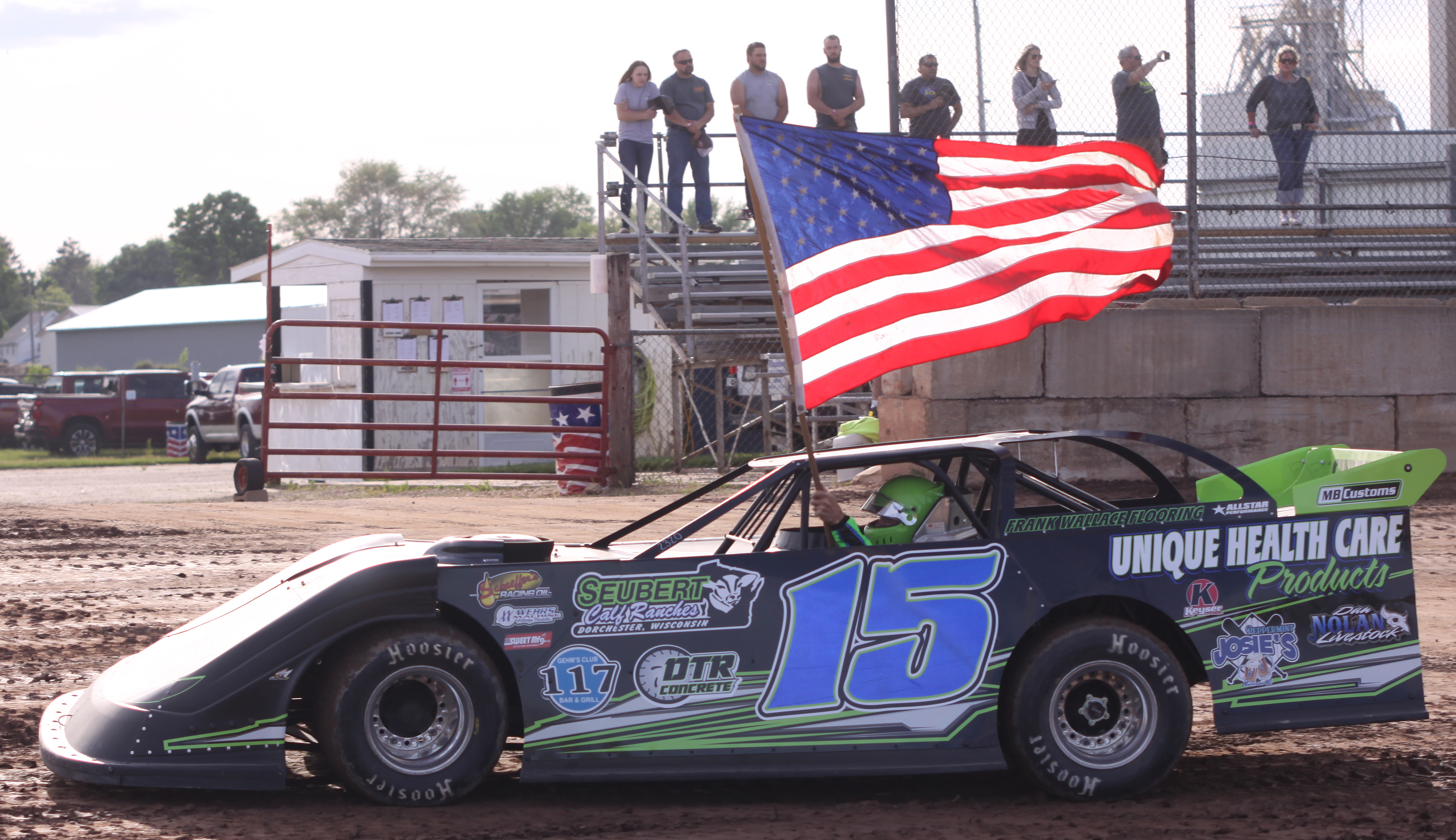 Nick Anvelink carries the U.S. flag as he drives around the track during the Shawano Speedway&#039;s season opener on Saturday. Drivers who won a 2019 title received the honor, with Anvelink having won the Late Model class last summer.<br />Morgan Rode | NEW Media
