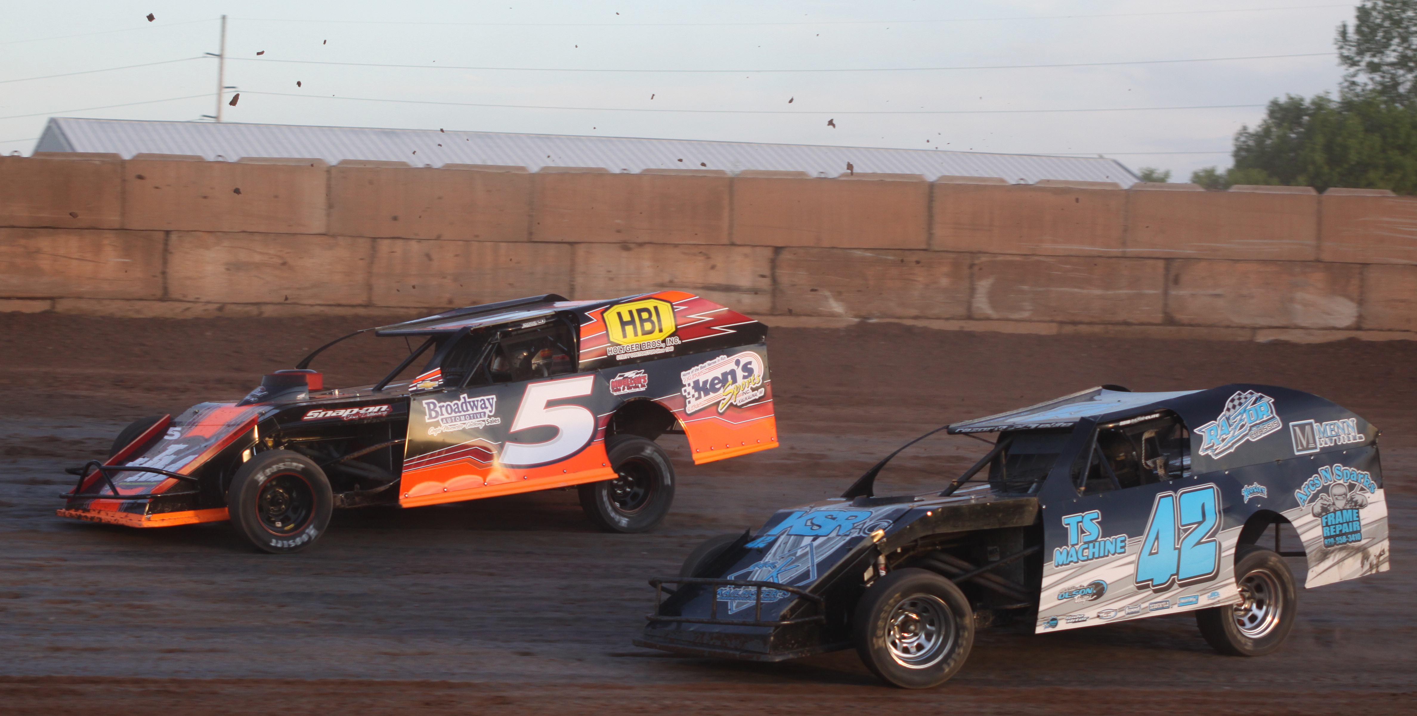 Eddie Muenster (5) and Jamie Schmidt (42) battle for position in a IMCA Modified heat race during Saturday&#039;s season opener at Shawano Speedway.<br />Morgan Rode | NEW Media