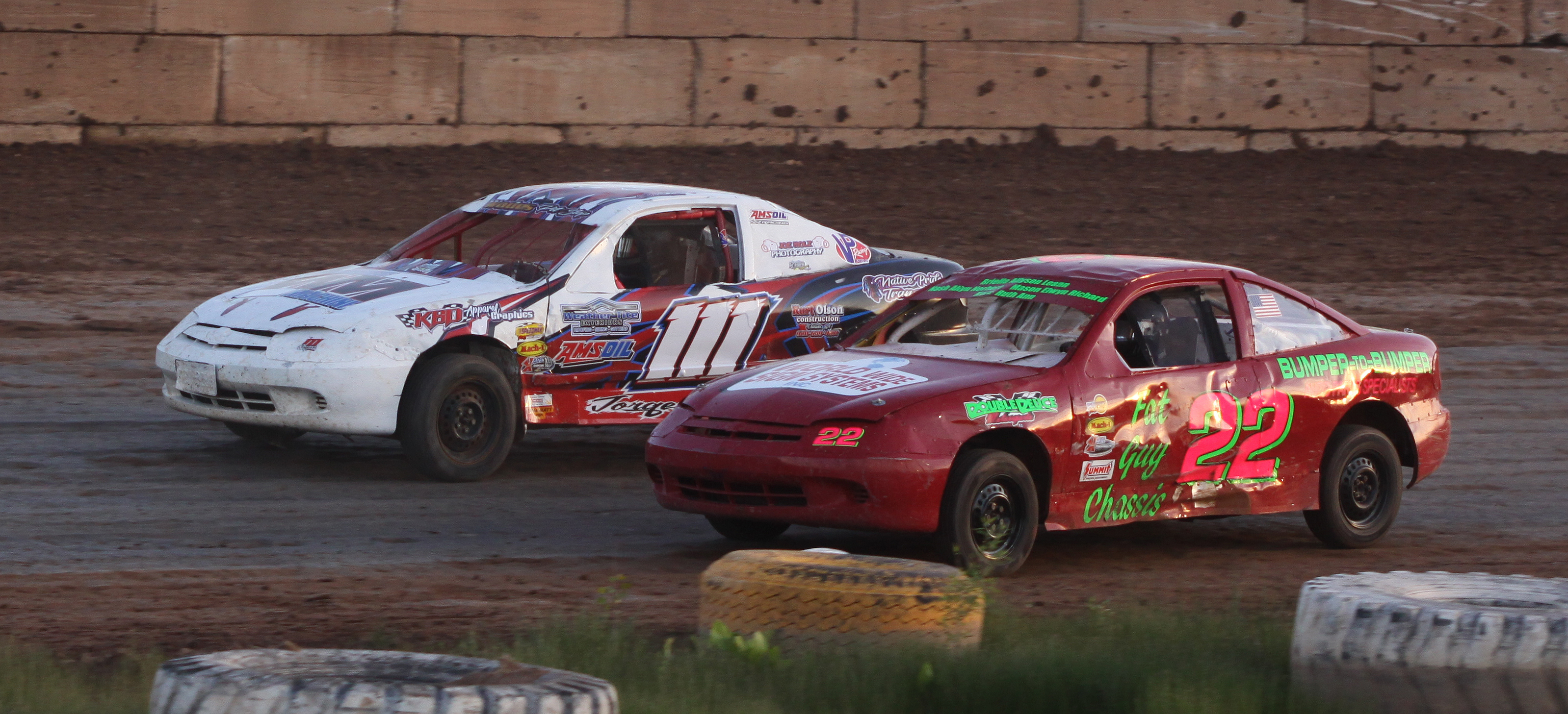 Kyle Jorgenson (111) and Clint Malueg (22) race side by side during a Mighty 4 heat race during the Shawano Speedway&#039;s season opener on Saturday.<br />Morgan Rode | NEW Media