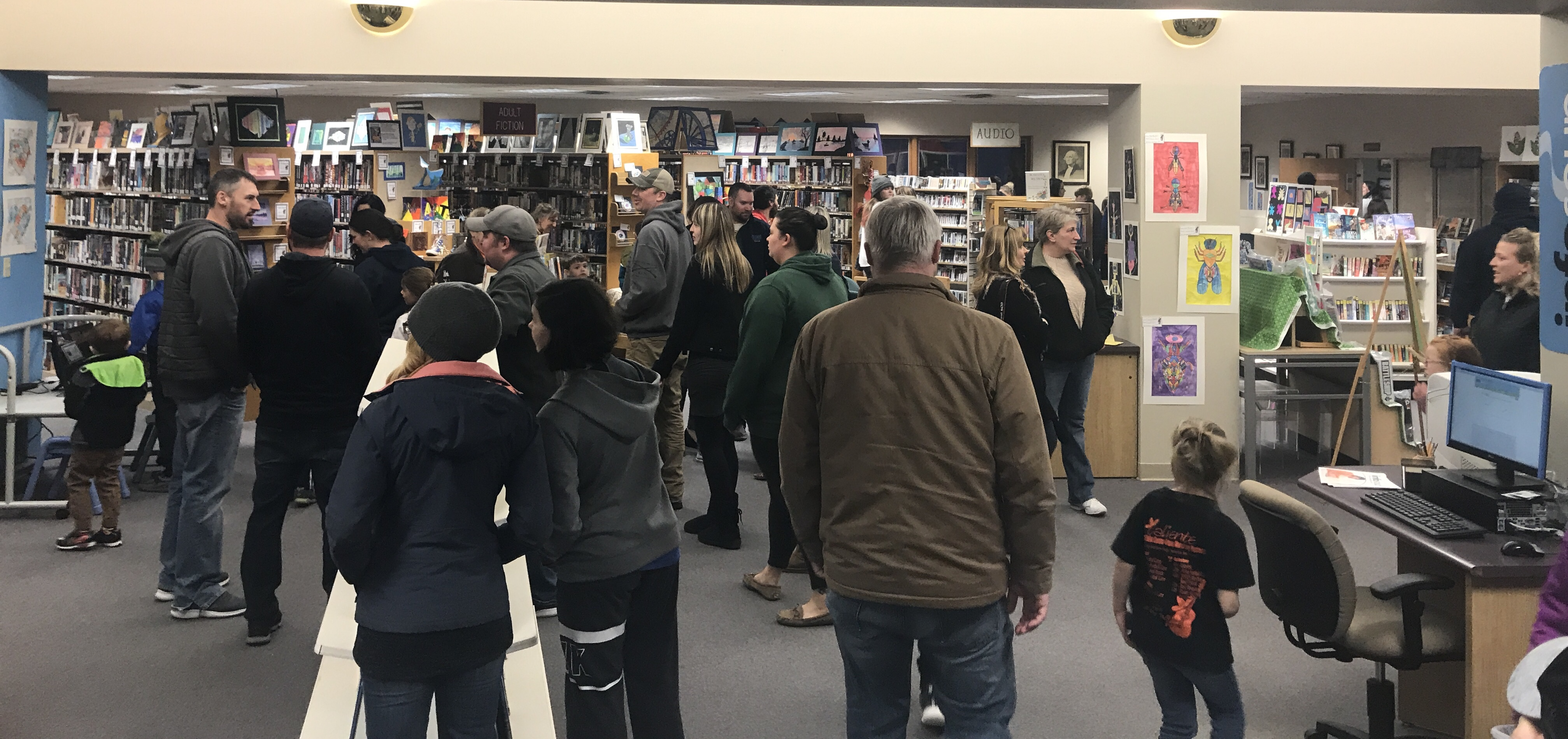 Oconto Falls Community Library was packed with visitors checking out the Youth Art Month exhibit March 4. Warren Bluhm | NEW Media