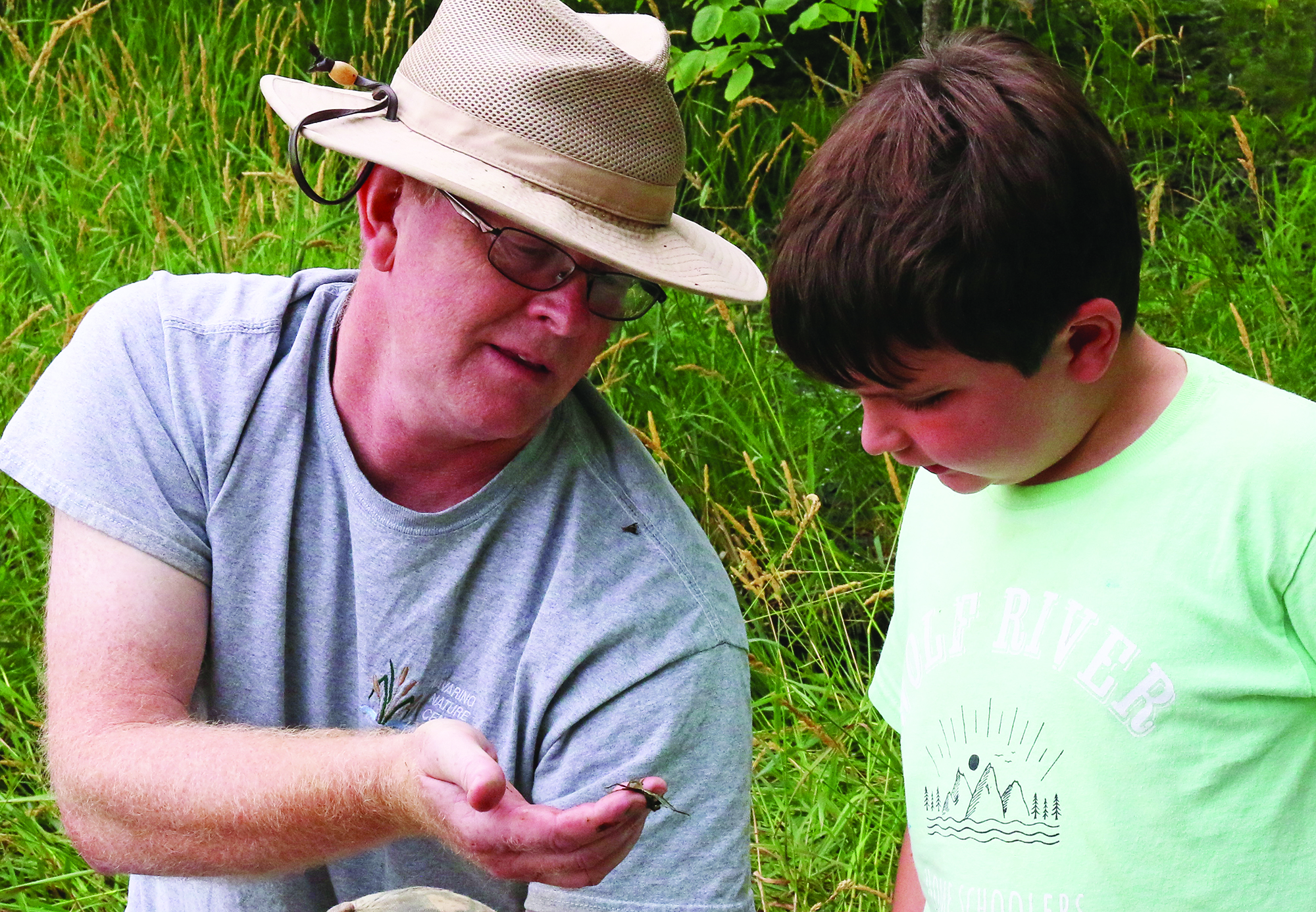 Tim Ewing talks about water insects with Matthew Briggs at Camp Creepy Crawly Critters at the Navarino Nature Center.Carol Ryczek | NEW Media