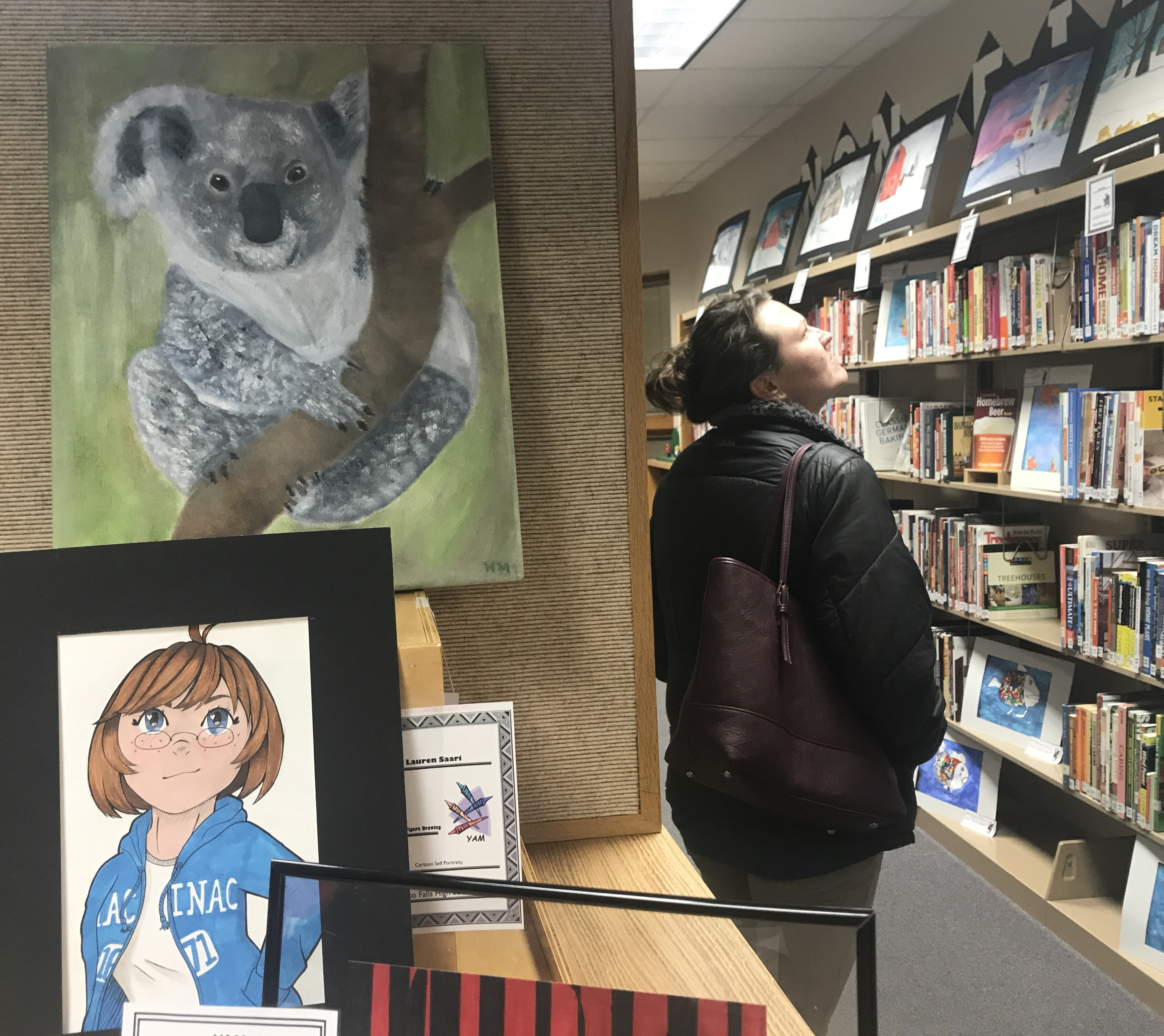 More than 400 works of art created by Oconto Falls School District students are on display this month at the Oconto Falls Community Library, and a few hundred people came out March 4 for the opening reception. Warren Bluhm | NEW Media