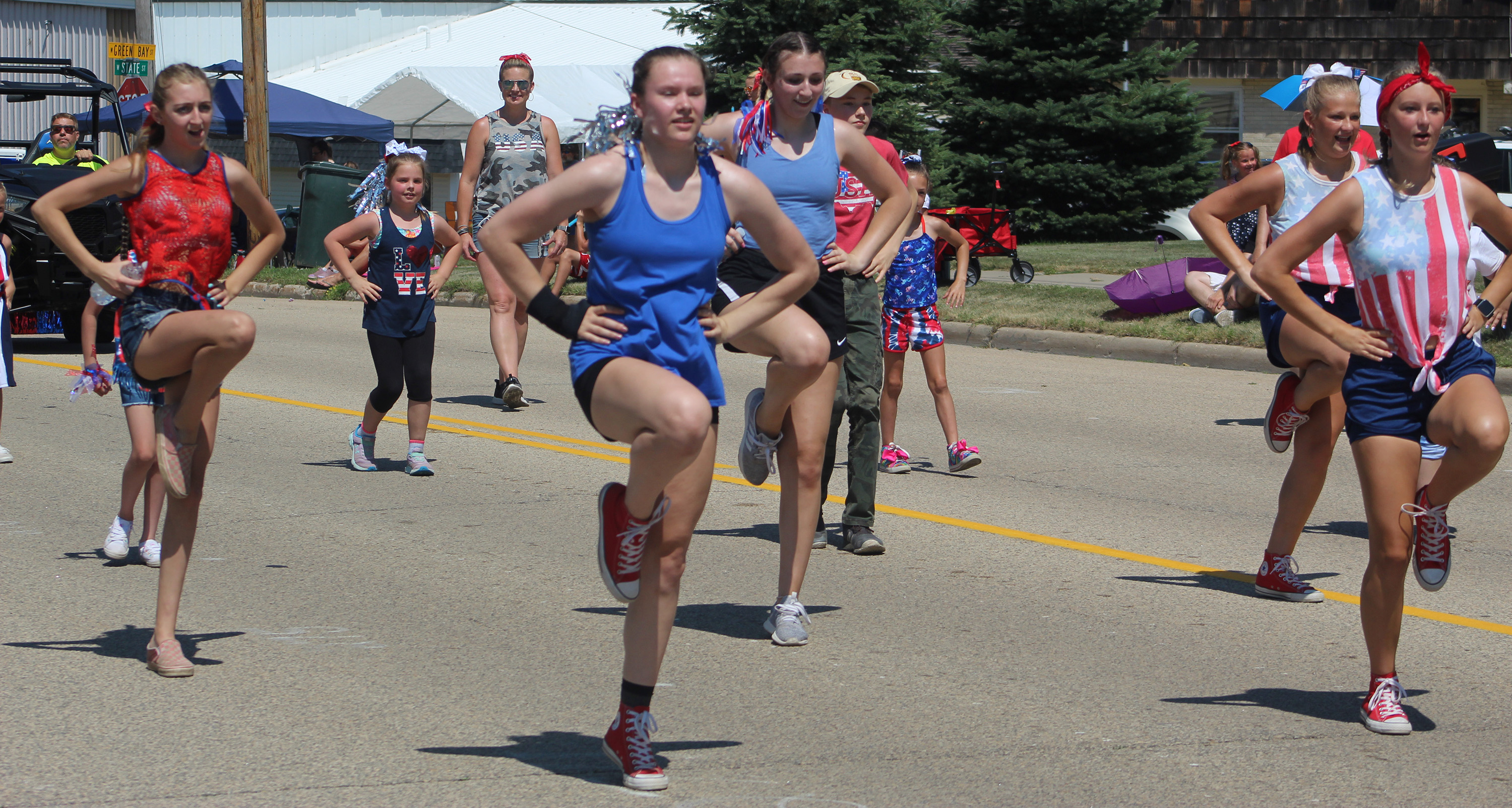 Members of the Sisu Academy of Dance and Gymnastics dance along the route Saturday for Bonduel's Independence Day parade.Lee Pulaski | NEW Media