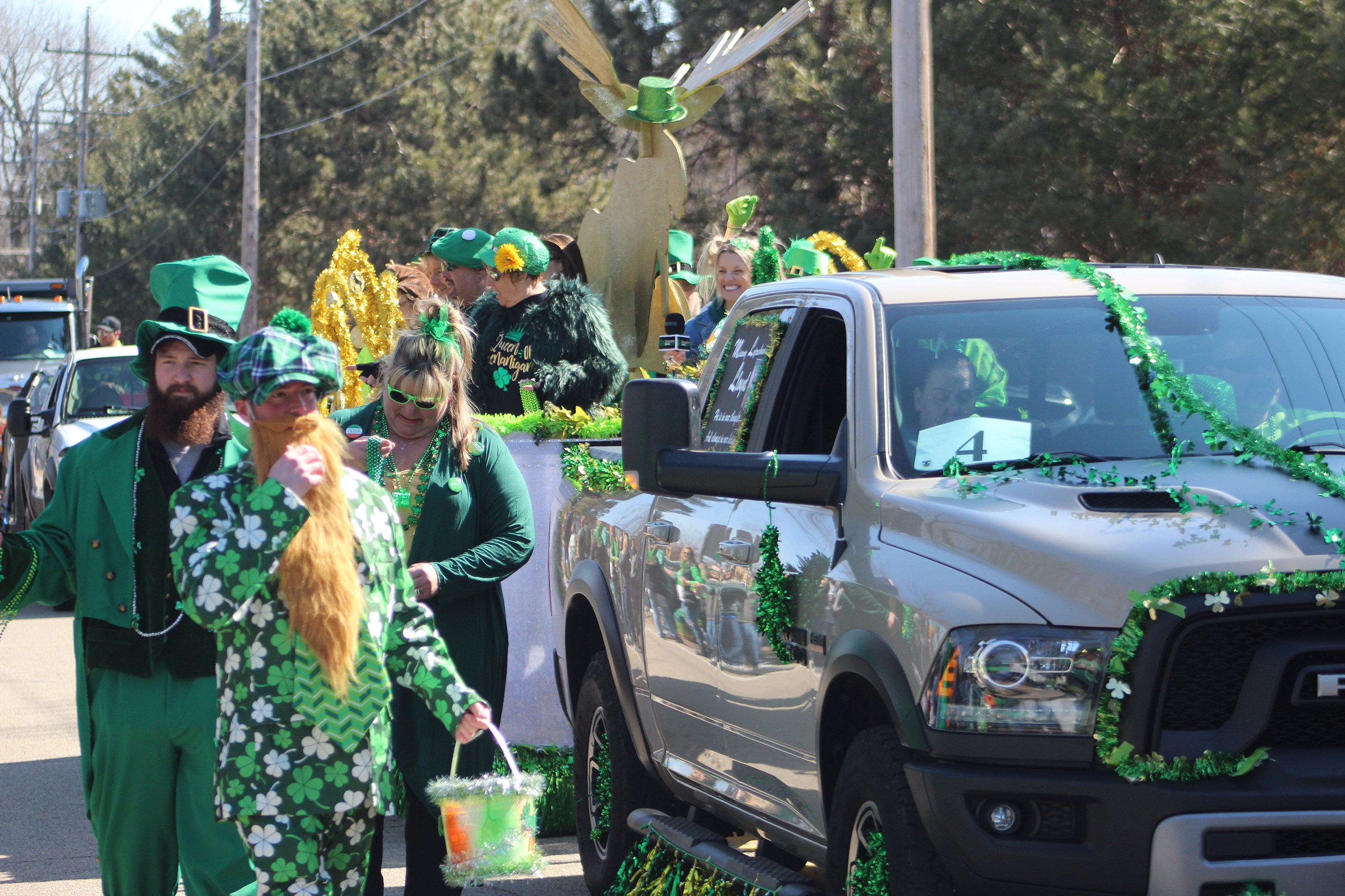 Leprechauns walk along Lake Drive on March 13 for the annual St. Patrick's Day parade, which lasted more than a half-hour and featured almost 30 entries.(Lee Pulaski | NEW Media)