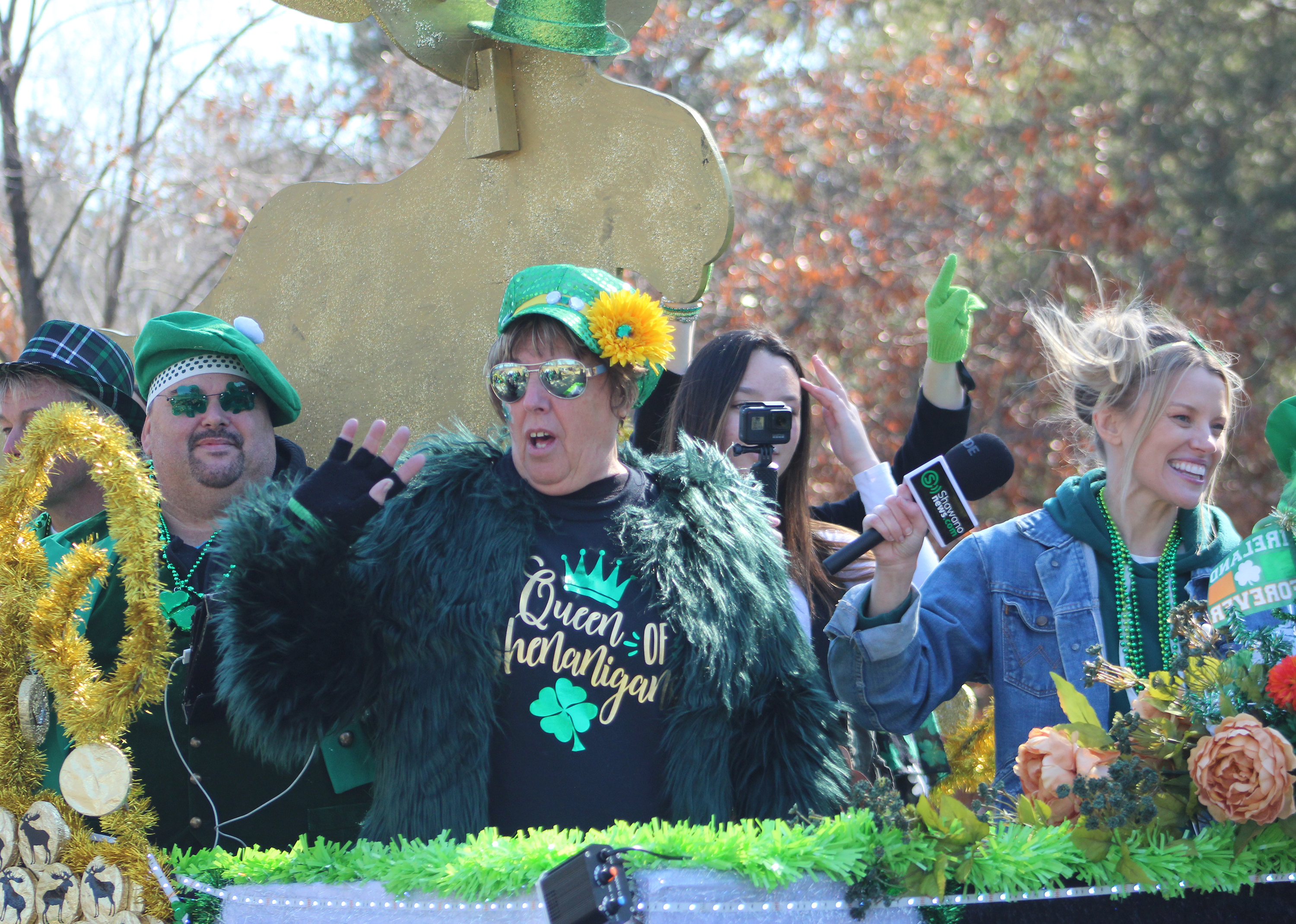 """It's unclear whether shenanigans were going on aboard this float from Just Moose'n Around, despite one of the passengers wearing a shirt that said """"Queen of Shenanigans."""" What was clear was that many were having a wonderful time during the Mooseyard St. Patrick's Day Parade on March 13.(Lee Pulaski 