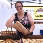 Nicole Wasmer packs some of her pizza-stuffed German pretzels for a Das Brot customer at the Oconto Falls Flea Market on June 13. Warren Bluhm | NEW Media