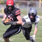 Shawano's Jacob Landon, left, runs with the ball after making a first-down catch in the team's homecoming game against Xavier on Sept. 25 in Shawano.  Morgan Rode | NEW Media