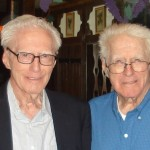100-year-old identical twins Mark, left, and Merne Gilles live about 1,000 miles apart but got together at the Bavarian Inn in Lena sometime in their early nineties, a moment preserved in this family photo. (Contributed)