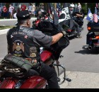 American Legion Riders follow the color guard at the head of the Gillett Fourth of July parade.