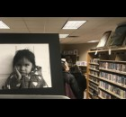 A portrait by Oconto Falls High School student Wendy Avila watches over the room at the Oconto Falls Community Library's Youth Art Month exhibit. Warren Bluhm | NEW Media