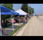 Green Bay Street was filled with tents as residents and visitors braved the heat to watch the Fourth of July parade pass in Bonduel on July 4.  Luke Reimer | NEW Media
