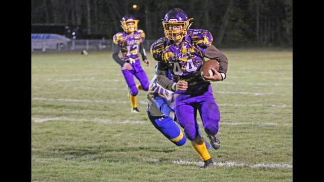 Suring's Logan Stuart runs with the football during a playoff game against Gibraltar on Oct. 25 in Suring. Stuart was named the offensive and defensive player of the year in the MONLPC-8 conference in his senior season. Carol Ryczek | NEW Media