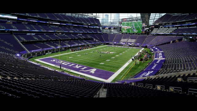Players get set on the field in U.S. Bank Stadium during the second half of Sunday's game between the Minnesota Vikings and Green Bay Packers in Minneapolis. No fans were in attendance, and no spectators will be allowed at the Packers home opener this Sunday.  Bruce Kluckhohn | The Associated Press