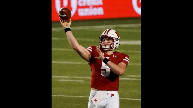 Wisconsin quarterback Graham Mertz throws a pass during the first half of Friday's game against Illinois in Madison.  Morry Gash | The Associated Press