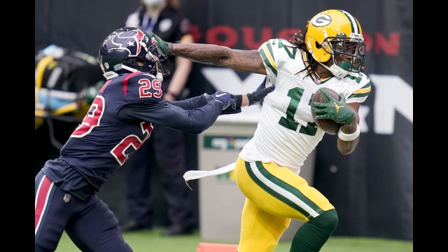 Green Bay Packers wide receiver Davante Adams, right, runs with the ball as Houston Texans cornerback Phillip Gaines tries to bring him down during the first half of Sunday's game in Houston.  Sam Craft | The Associated Press
