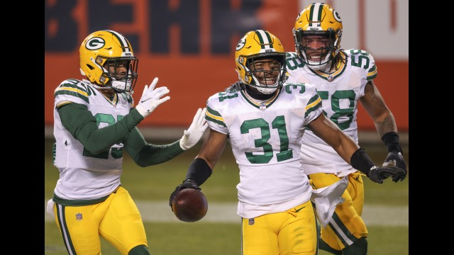 Green Bay Packers safety Adrian Amos celebrates with teammates after intercepting a pass against the Chicago Bears on Jan. 3 in Chicago.  Kamil Krzaczynski   The Associated Press