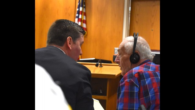 Attorney Lee Schuchart, left, talks with his client Raymand Vannieuwenhoven, of Lakewood, just before jury selection gets underway July 19 in the defendant's trial for the 1976 murders of David Schuldes and Ellen Matheys in a Marinette County park. The trial is expected to last up to two weeks. (Warren Bluhm | NEW Media)