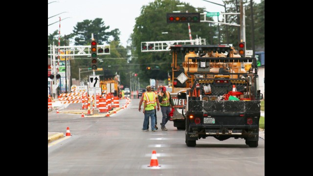 Workers from Century Fence put the finishing touches on the East Green Bay Street and Fairview Way intersection on Thursday. The intersection is near one of the main entrances to the Shawano County Fairgrounds. The crew was painting stripes on the recently-poured pavement.  Carol Ryczek | NEW Media