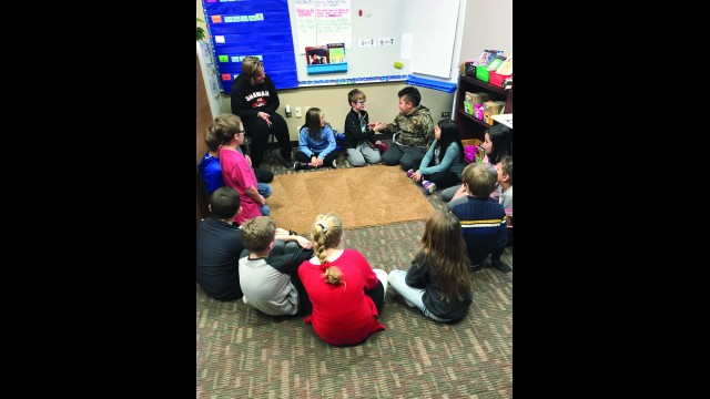 Third grade students at Olga Brener Intermediate School share a greeting Tuesday in the classroom's morning meeting. Besides the meetings that teach social and emotional learning, there are also safe zones in the classrooms where students can go when they feel overwhelmed.  (Terri Schultz)