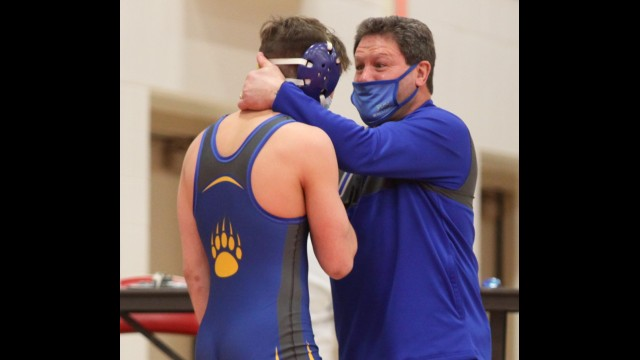 Bonduel wrestling head coach Chris Rank, right, gives Max Sokolski a final pep talk before his first state match on Feb. 13 at Wausau East High School. Rank decided to retire from coaching after serving as the team's head coach the past 23 seasons.
