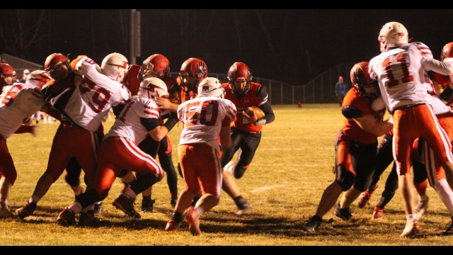 Shawano's Gage Timm, center, and runs through an opening to score a touchdown during the team's playoff win over Seymour on Thursday in Shawano.  Morgan Rode   NEW Media