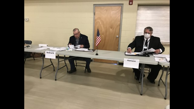 Oconto County Board Chairman Paul Bednarik, left, and Administrative Coordinator Kevin Hamann prepare for the May 21 board meeting at Holy Trinity Parish Hall in Oconto.  Warren Bluhm | NEW Media