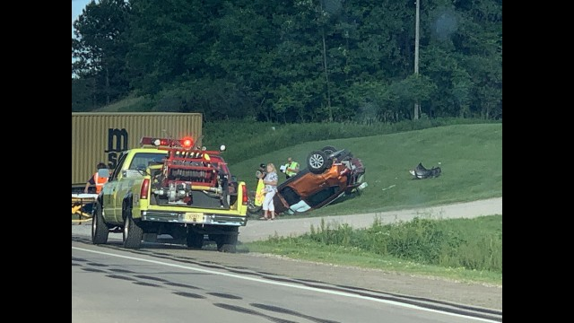 A flipped car lays on the side of the State Highway just east of Wittenberg, in the Town of Morris on June 15.  Luke Reimer | NEW Media