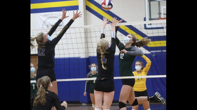 Wittenberg-Birnamwood's Abi Fraaza, second from right, tips the ball over the net as Bonduel's Halea Sporisky (4) and Josie Hoffman (12) try to block it during Tuesday's CWC-East match in Bonduel.  Morgan Rode | NEW Media