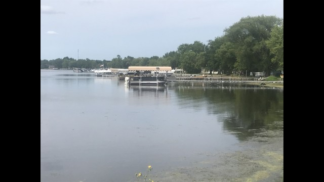 A row of boat docks along the Shawano Lake shoreline in Cecil. The U.S. Federal Energy Regulatory Commission on July 21 granted a two-year amendment allowing Eagle Creek Renewable Energy to bring the water level to its historical level of 802.9 feet above mean sea level year-round. (Warren Bluhm | NEW Media)