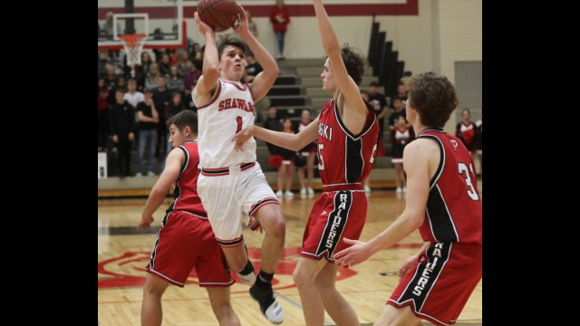 Shawano's Kaleb Lowney, second from left, goes up for a shot during Friday's nonconference victory over Pulaski in Shawano.  Morgan Rode | NEW Media