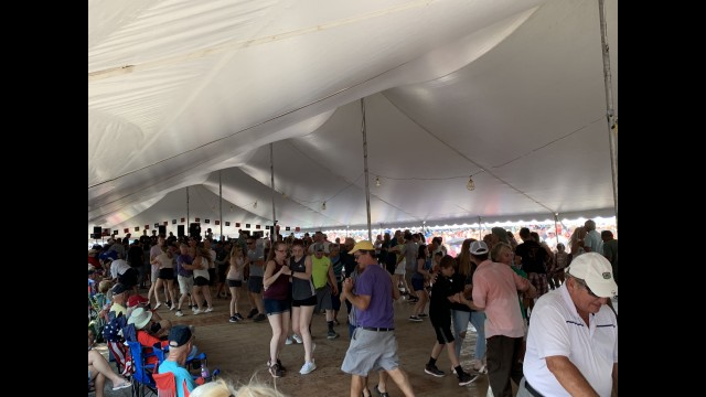 Tent 1 is packed with many different duos as they dance to the music of the Polka Family band on July 18.  Luke Reimer | NEW Media