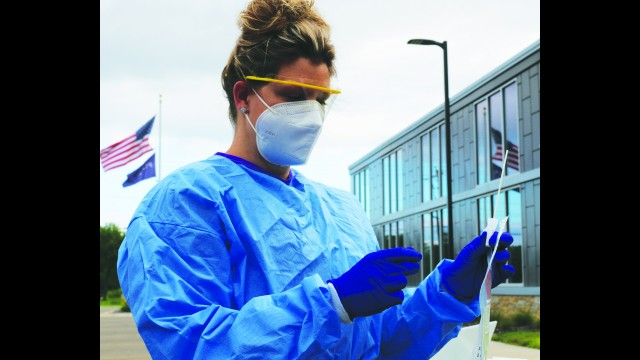 Theresa Arndt gets ready to administer a COVID-19 test at the Prevea Clinic in Shawano. Drive-up testing is now available in several locations in northeast Wisconsin for patients who have symptoms or have been exposed to someone who tested positive for the virus.  Carol Ryczek | NEW Media
