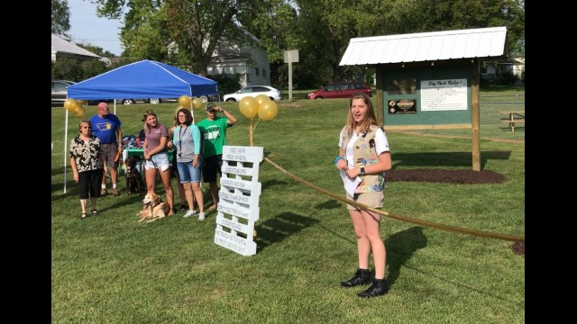 Emily Gonnering addresses the crowd that gathered Saturday morning, Aug. 19, for the opening of the Oconto Falls Dog Park. Warren Bluhm | NEW Media