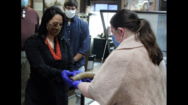 Stockbridge-Munsee Tribal President Shannon Holsey accepts a powder horn owned by the late John W. Quinney from Anna Cannizzo, assistant director of the Oshkosh Public Museum, during a private ceremony held Nov. 19 at the Arvid E. Miller Library and Museum. The Oshkosh museum had previously loaned the horn to the tribe a year ago, and tribal cultural representatives petitioned the museum to repatriate the object, as Quinney was a respected lobbyist for the tribe.  (Lee Pulaski   NEW Media)