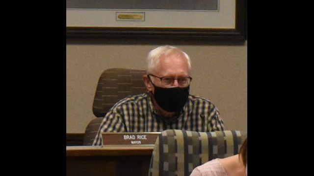 Mayor Brad Rice presides at the Oconto Falls City Council meeting on April 13, when he broke a 3-3 tie to continue a mask mandate at council meetings until July. 
