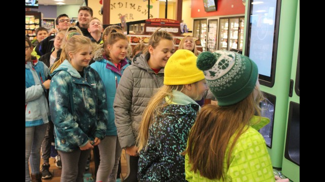 Bonduel Elementary School sixth grade students line up Thursday afternoon at the smoothie machine at the Kwik Trip in Bonduel to get a treat in recognition for being leaders and good examples to younger students at the school.  (Lee Pulaski | NEW Media)