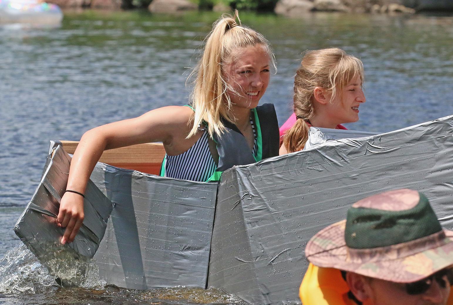 Paige Danen, left, and Sami Danen came in second in the cardboard regatta at Tilleda Falls — a small, private campground near Gresham.Carol Ryczek   NEW Media