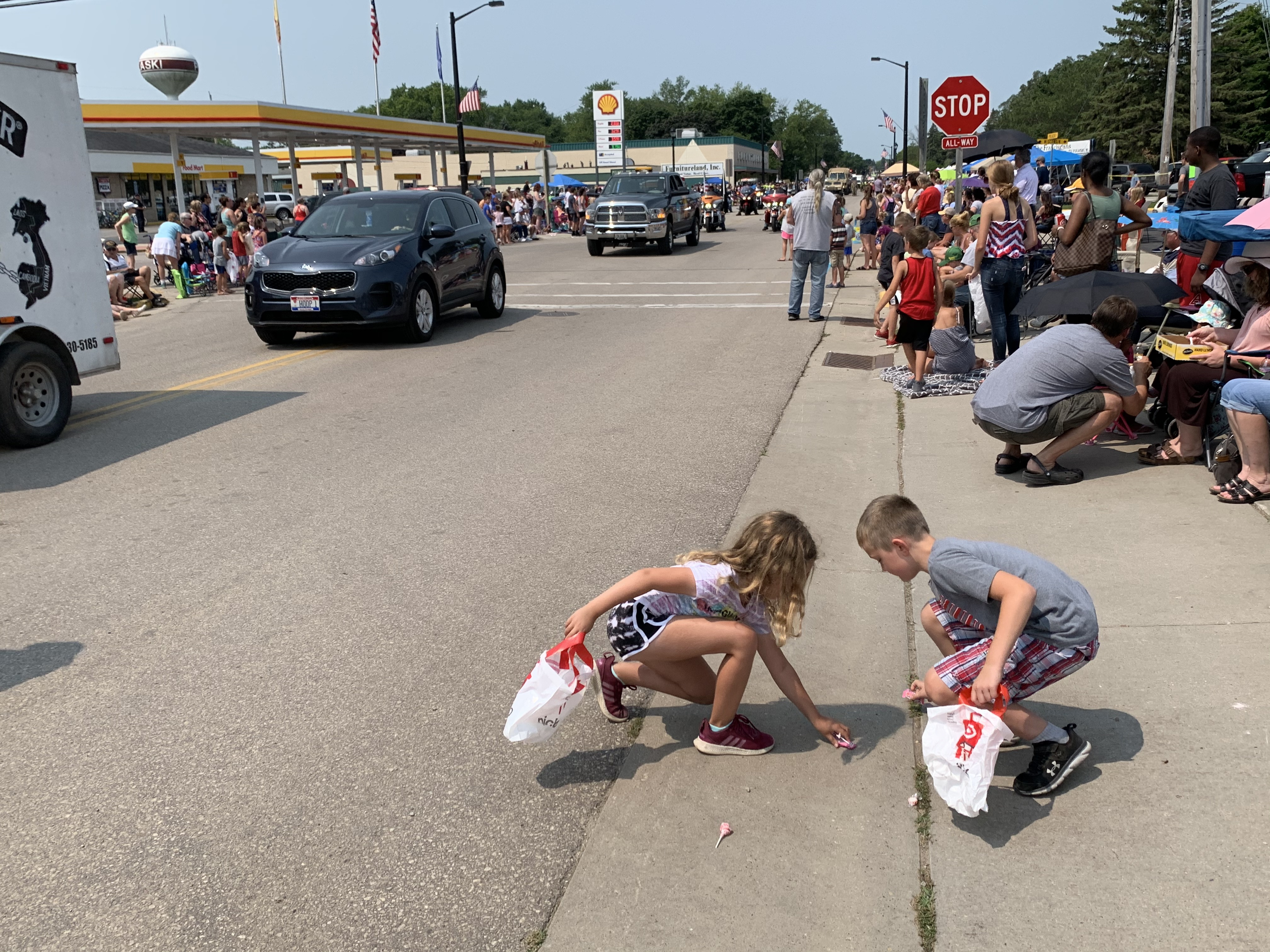 Amelia and Logan Kaiser collect candy that was thrown from parade floats on July 18. They traveled with their family from Eland to partake in the parade and listen to polka music.Luke Reimer   NEW Media