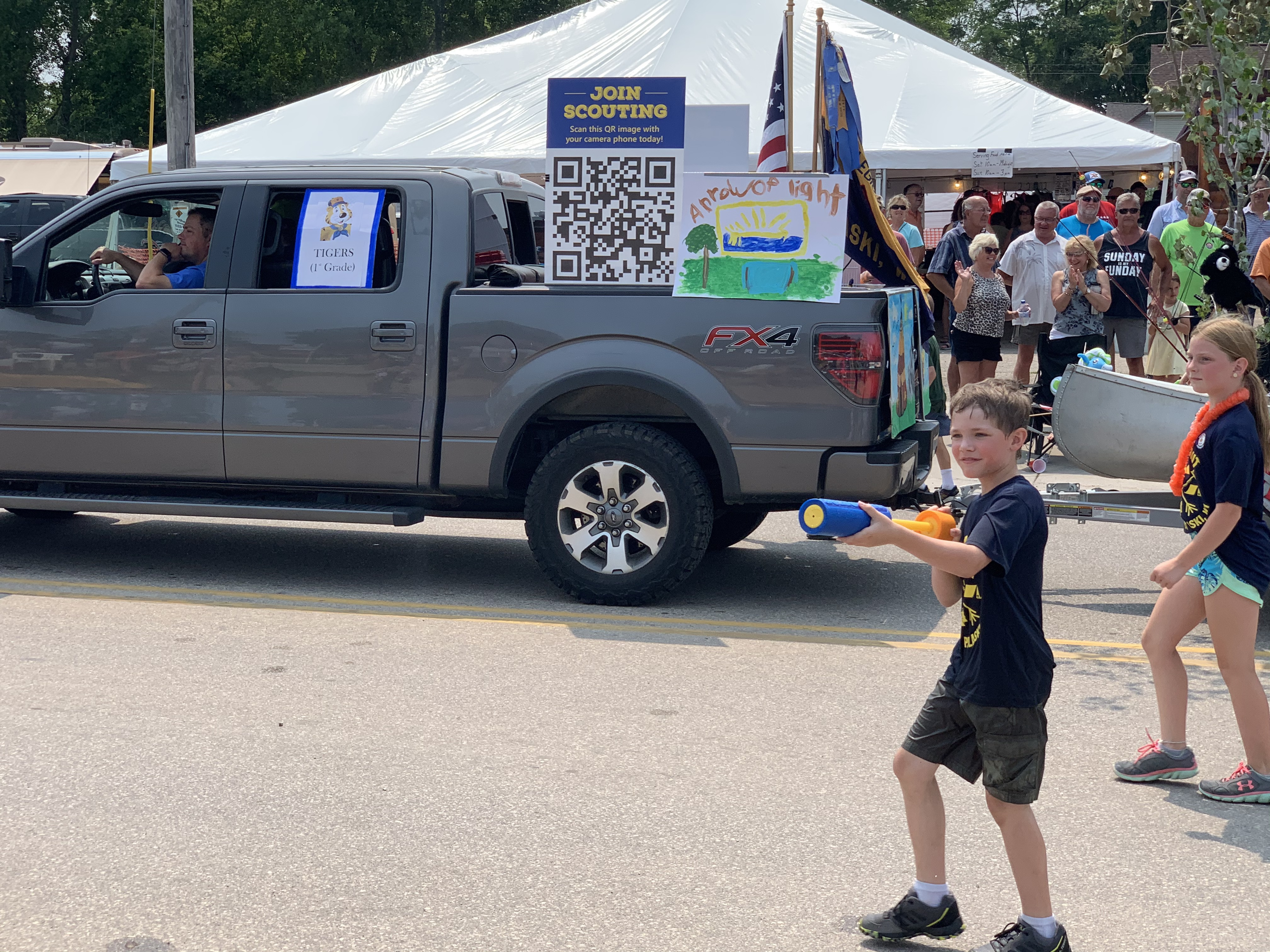Some floats featured kids walking along side the vehicles squirting parade visitors with water as temperatures reached 80-plus degrees on July 18.Luke Reimer   NEW Media