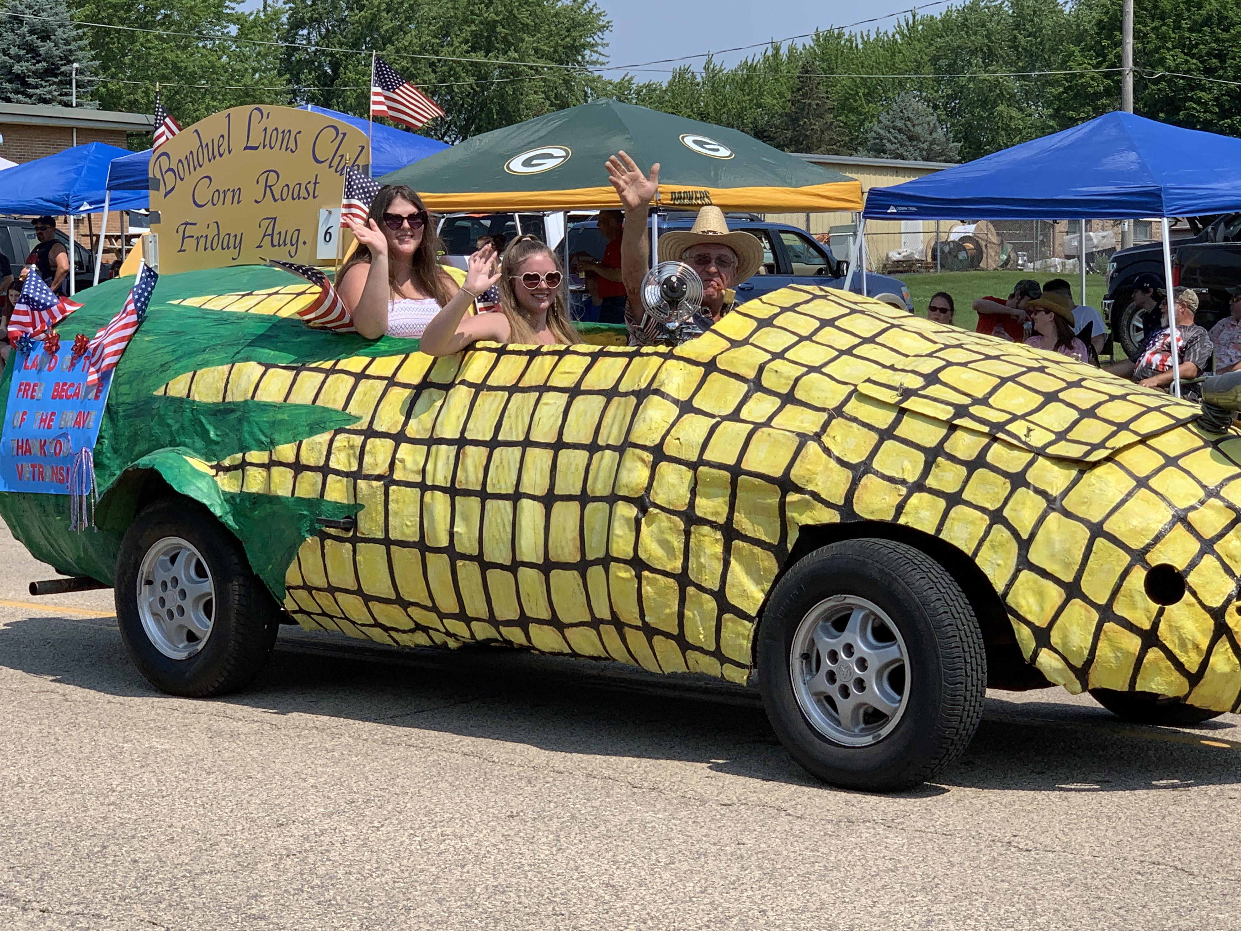 A corn-mobile drives down Green Bay Street, promoting the Bonduel Lions Club's upcoming corn roast, on July 4 in Bonduel.Luke Reimer | NEW Media