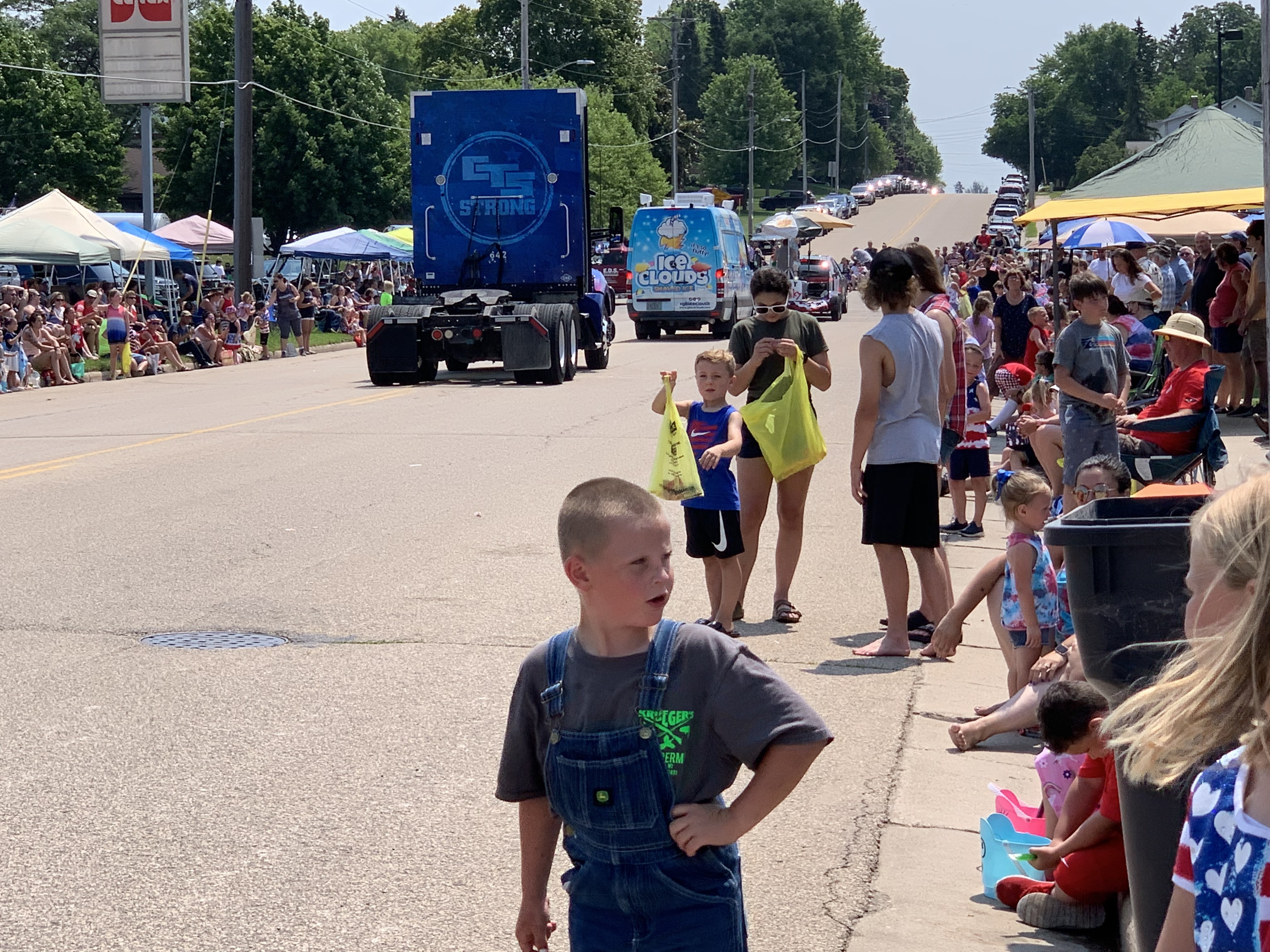 Children and teenagers wait to collect candy from parade floats in Bonduel on July 4.Luke Reimer | NEW Media