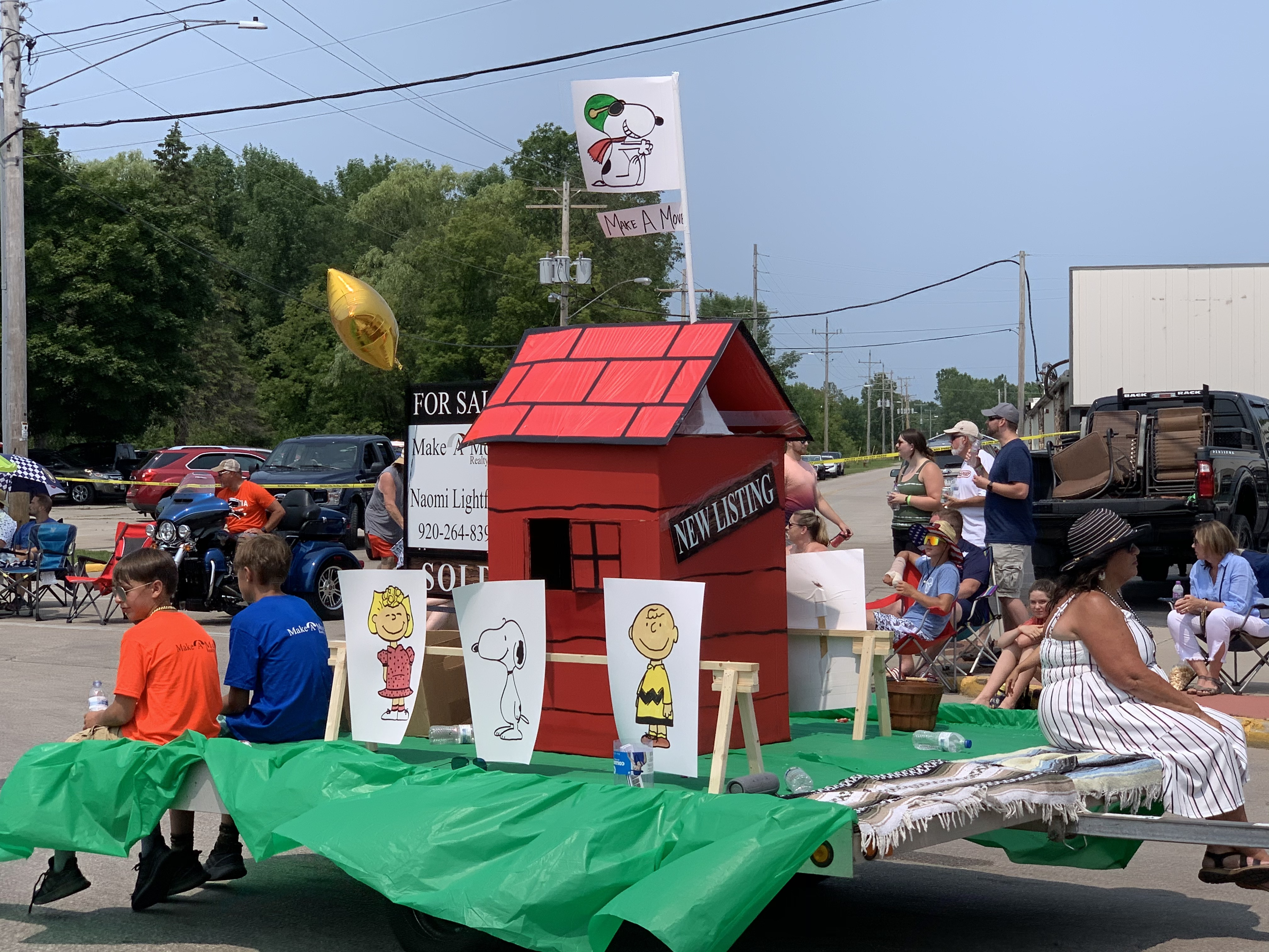 Many parade visitors felt a sense of nostalgia as a float promoting Charlie Brown, his friends and Snoopy's dog house passed by on July 18 on Pulaski Street.Luke Reimer   NEW Media