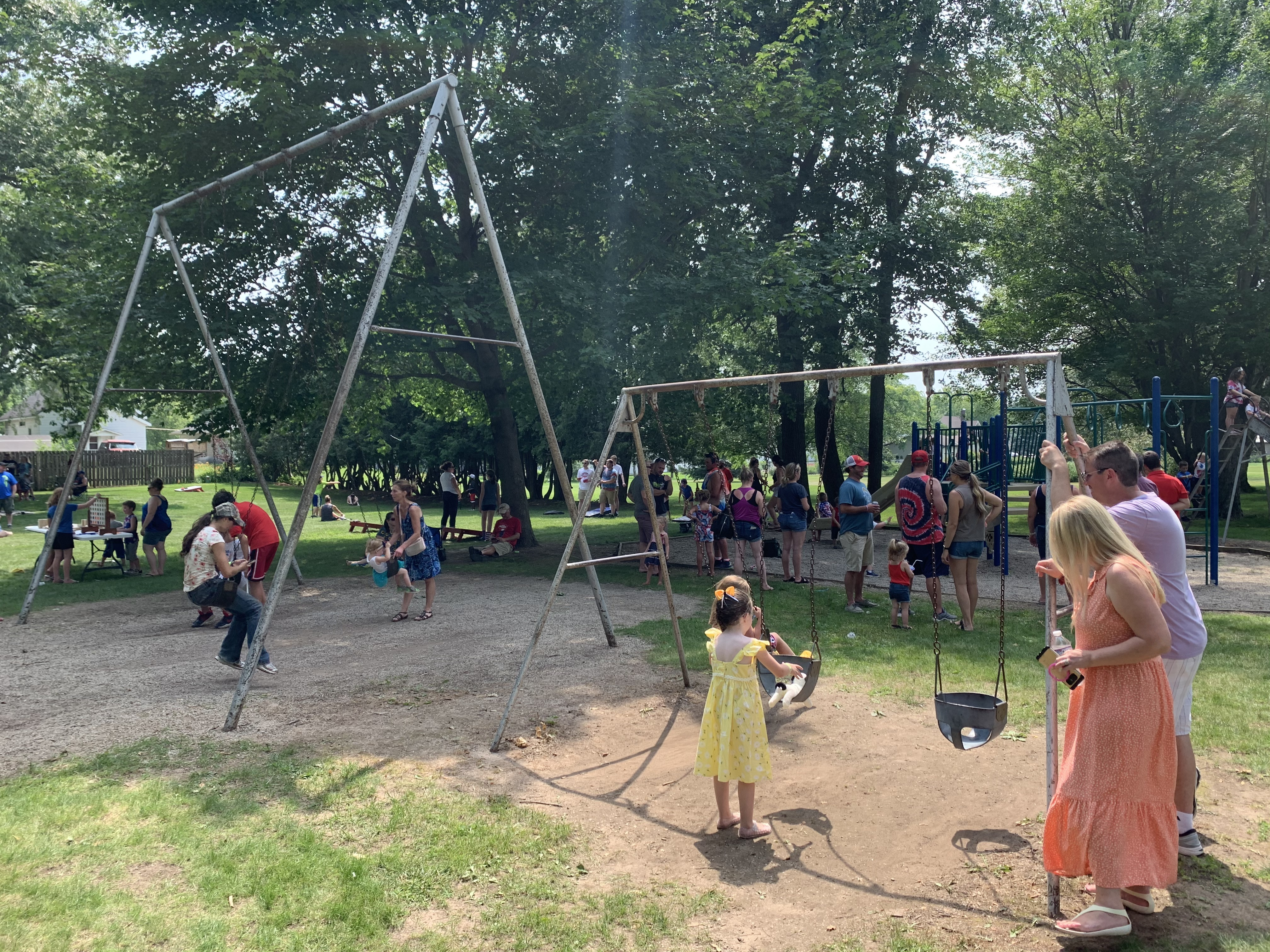 Families take a break from the Fourth of July celebration activities to play in Village Park in Bonduel on July 4.Luke Reimer | NEW Media