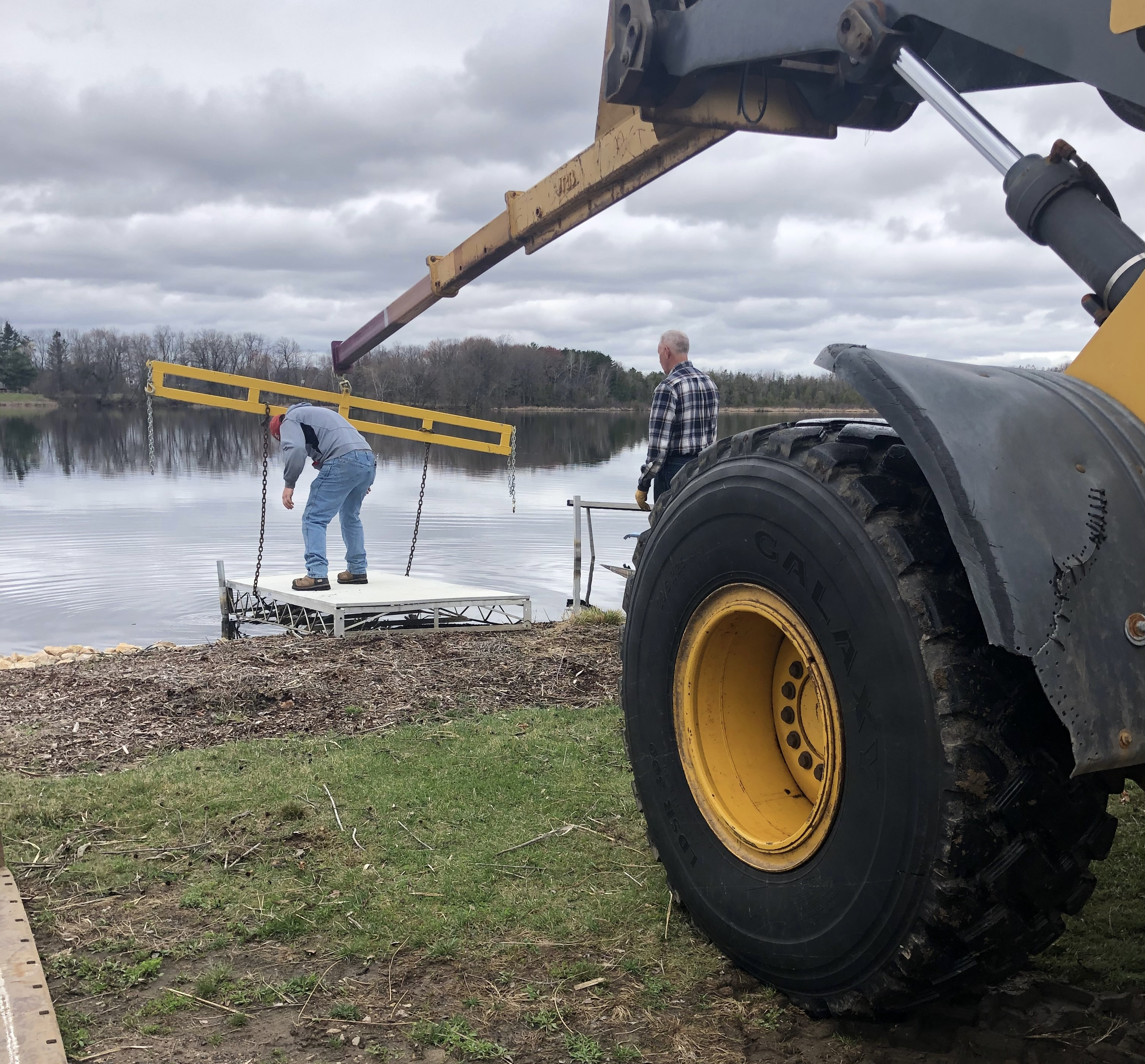 Shawano Ski Sharks seasonal preparation began placing docks, Saturday at their show site on the East bank of the Wolf River. The site is just North of Smalley Park in Shawano. The Shawano Ski Sharks 2021 season includes a performance every Wednesday June 9- August 18, 2021.<br />Submitted Photo