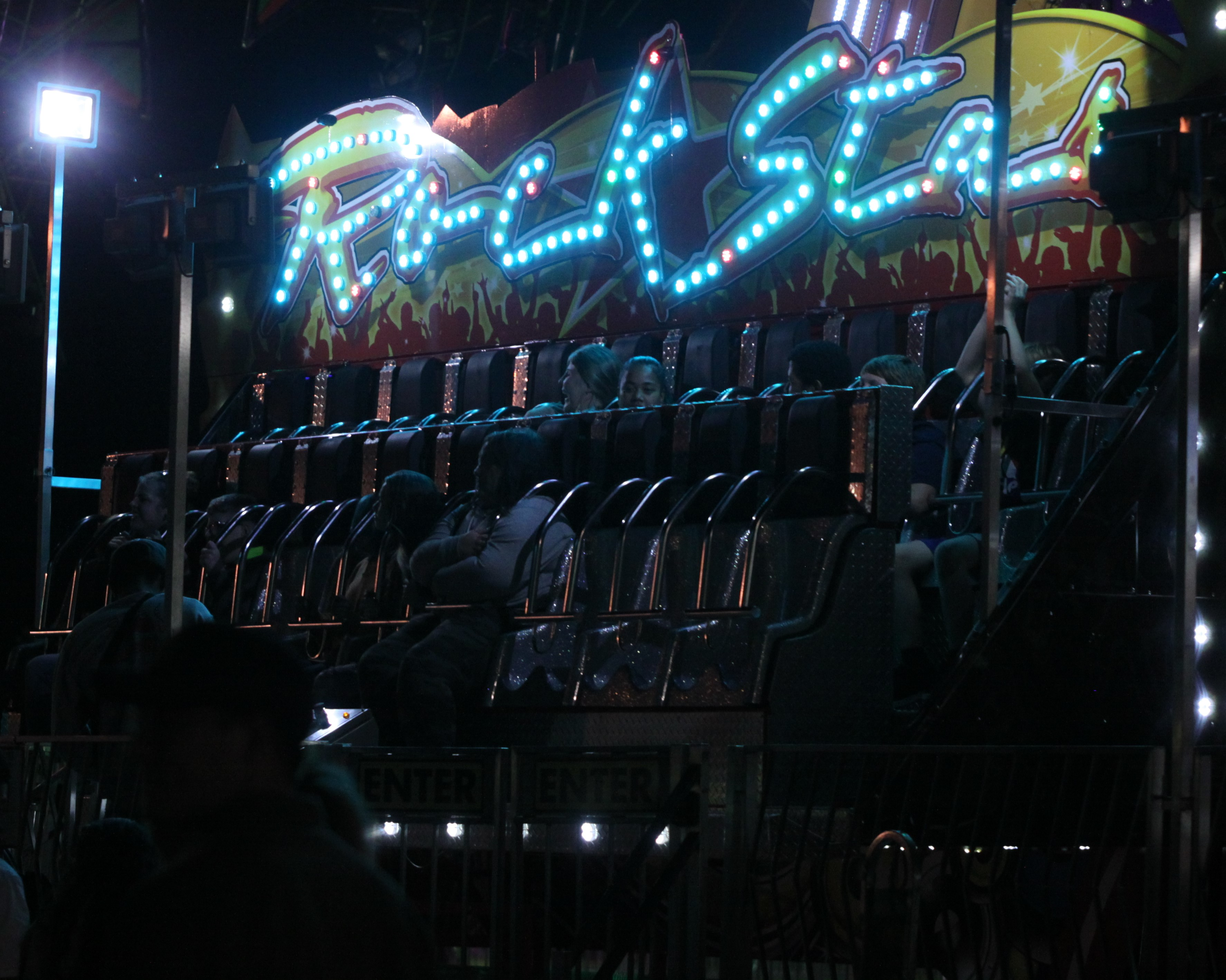 Bright lights illuminate the faces of visitors on rides at the Shawano County Fair on Sept. 4.<br />(Morgan Rode   NEW Media)