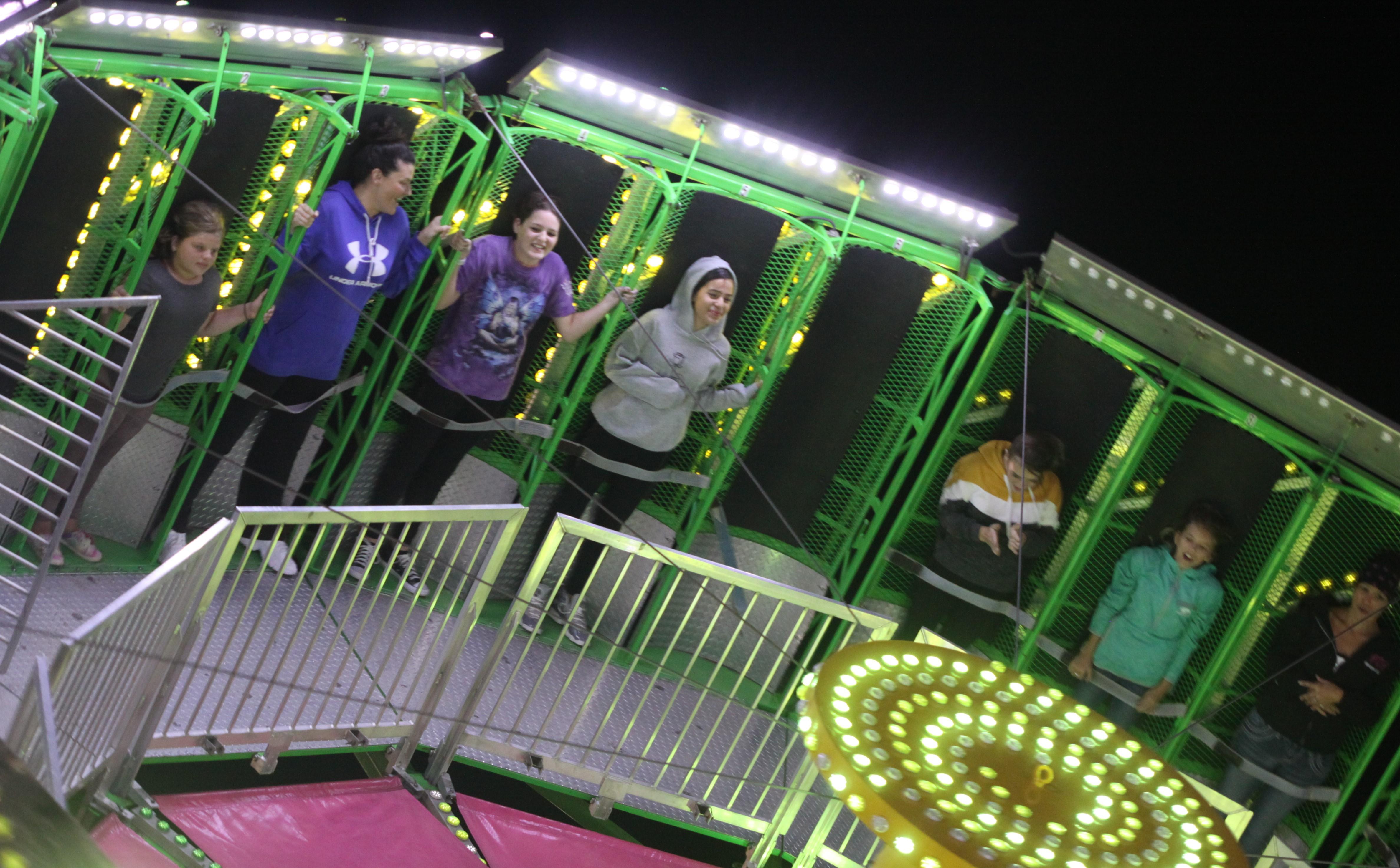 Visitors hang on while enjoying a ride at the Shawano County Fair on Sept. 4.<br />(Morgan Rode   NEW Media)