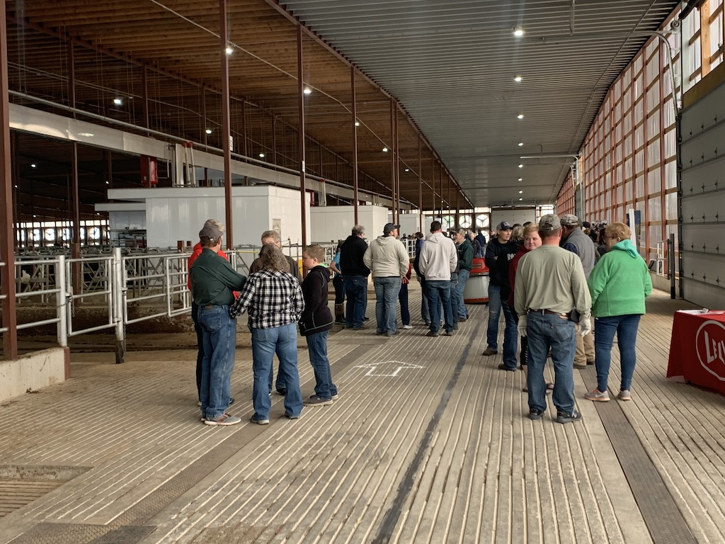 Visitors congregate in the barn to discuss the new farming method, as well as to socialize on April 24.<br />Luke Reimer | NEW Media
