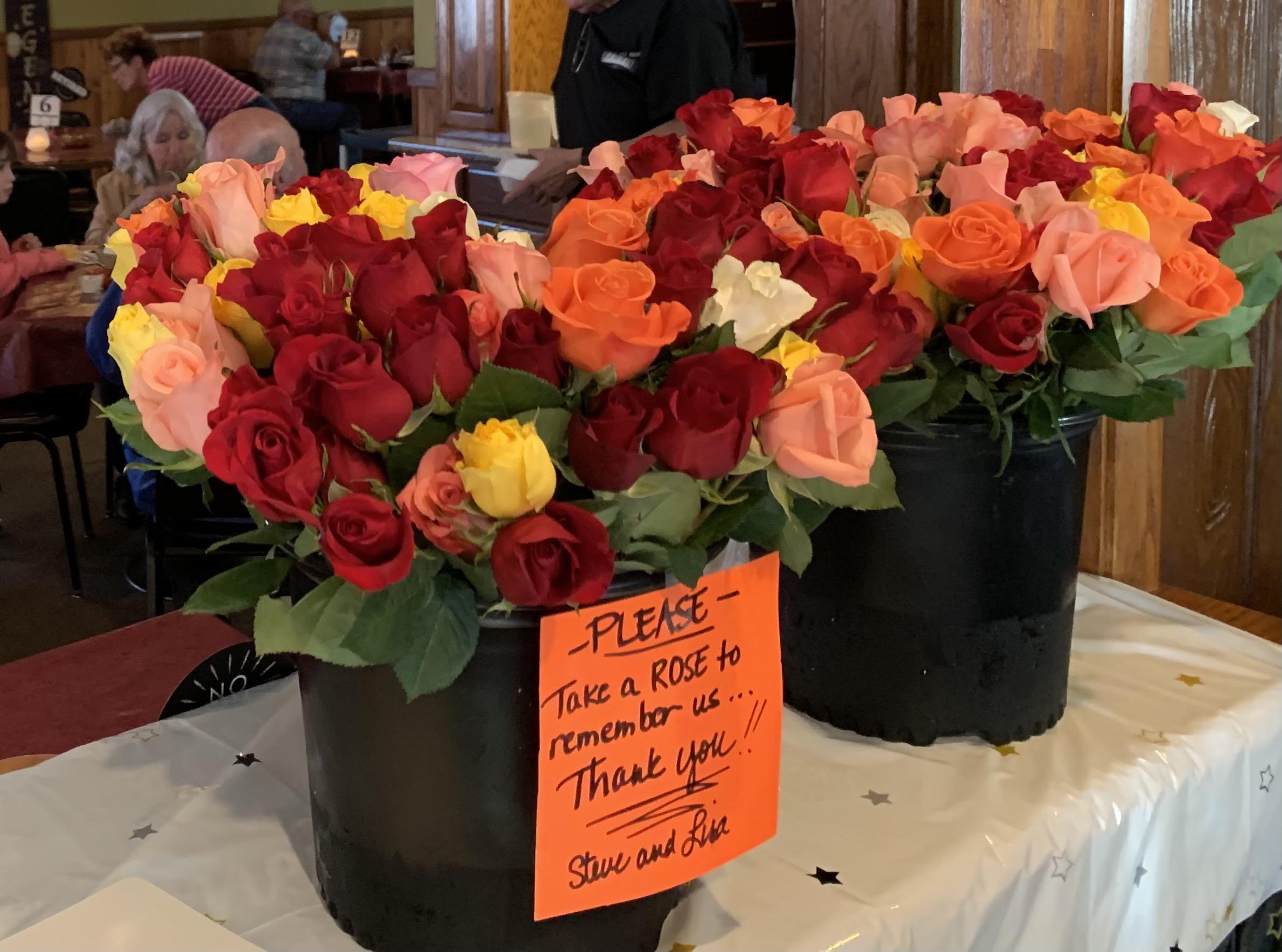 Roses were handed out at the Spinning Wheel Inn on April 29 for Steve and Lisa Lemhouse's last night running the restaurant.Luke Reimer | NEW Media