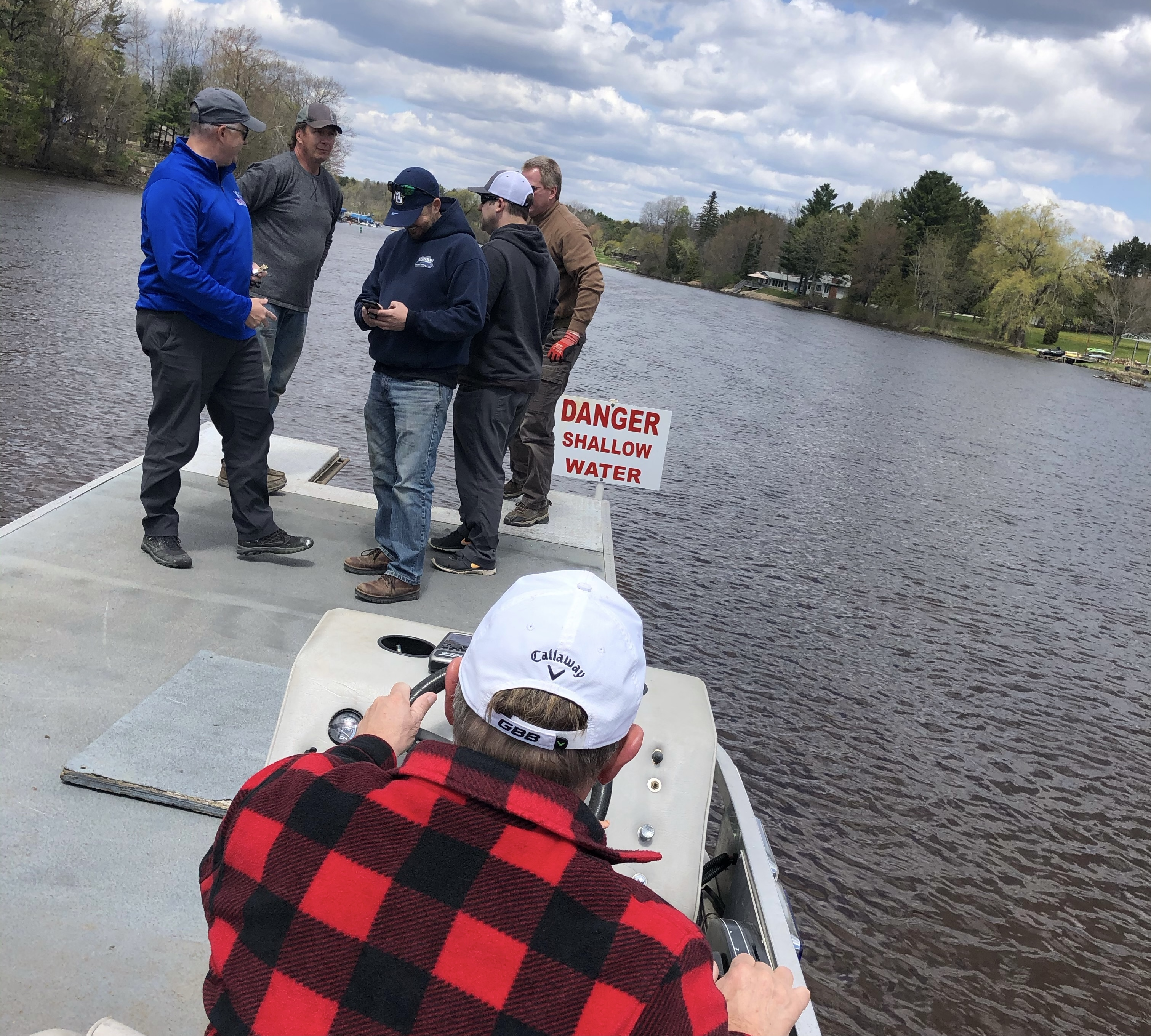 Members of Shawano Area Waterways Management ride out on the water in a channel that connects Shawano Lake and the Wolf River May 6 to place buoys in the water in preparation for boating season.Greg Mellis   NEW Media